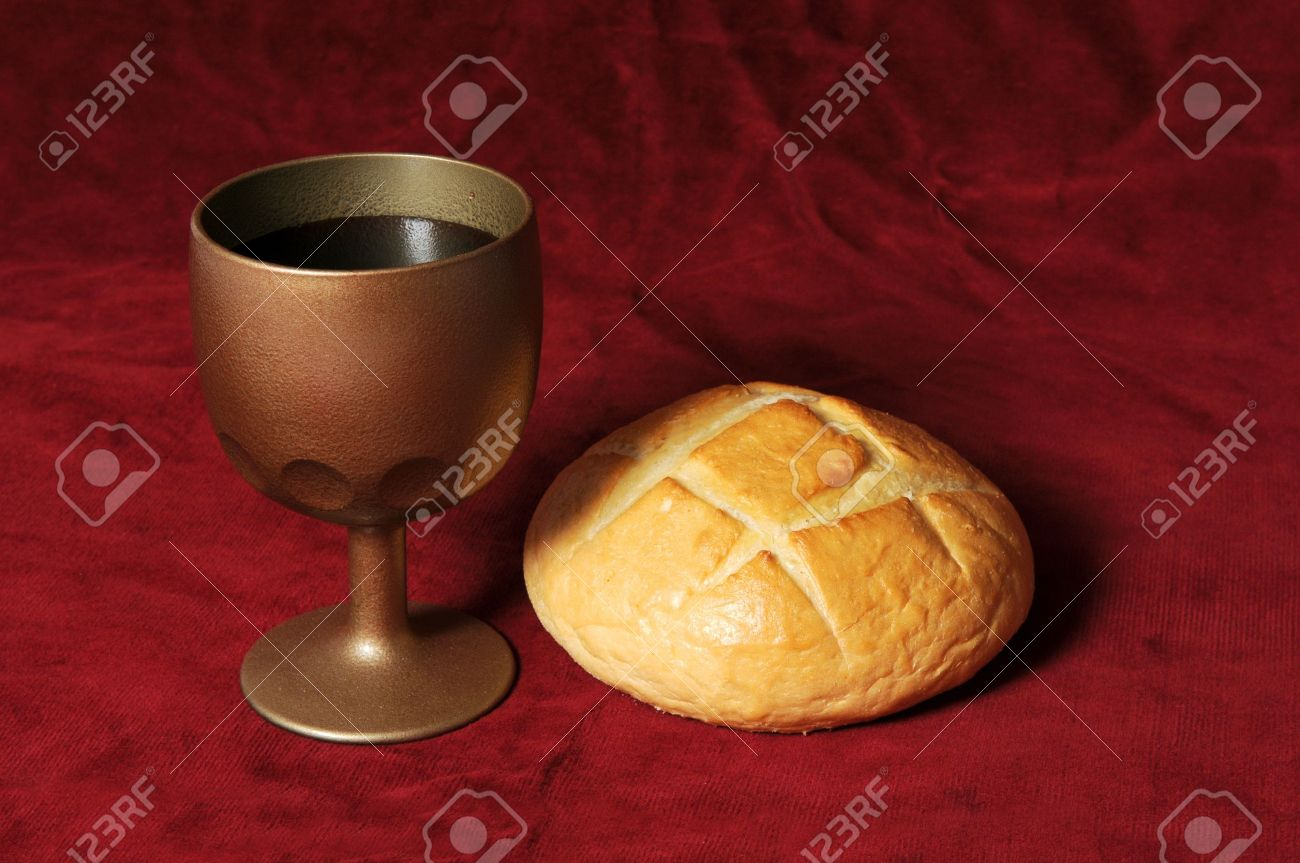 Communion elements represented by bread and wine over a red background Stock Photo - 7751806