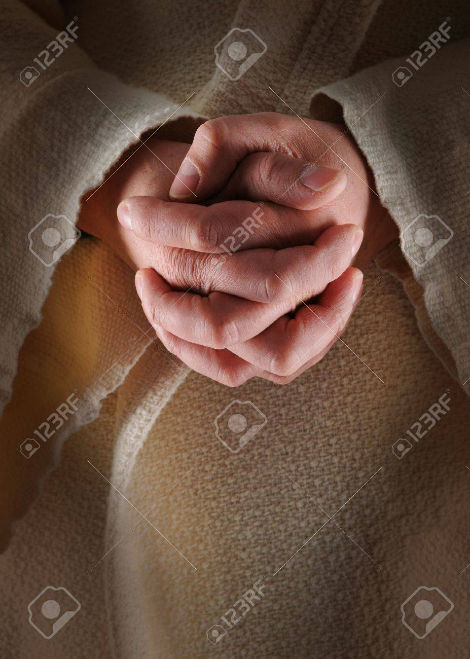 The hands of Jesus in clasped in prayer Stock Photo - 7752231