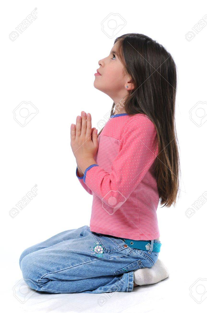 Little Girl Praying With Hands Together Over A White Background
