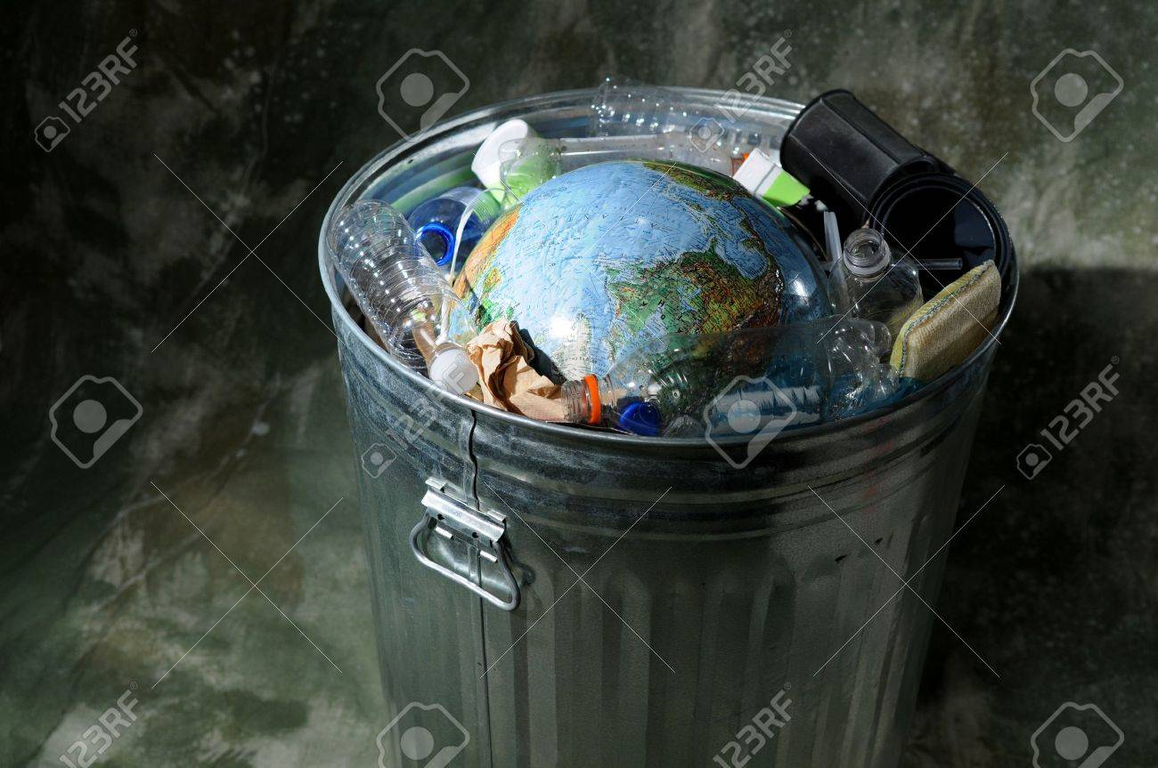 Earth in a trash can with plastics and rubbish Stock Photo - 7793670
