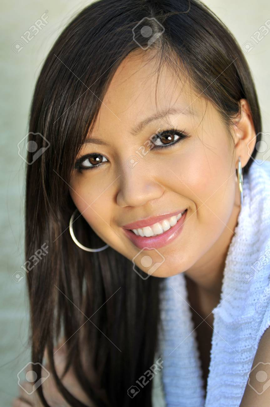 Portrait of beautiful young Asian woman smiling Stock Photo - 7795171
