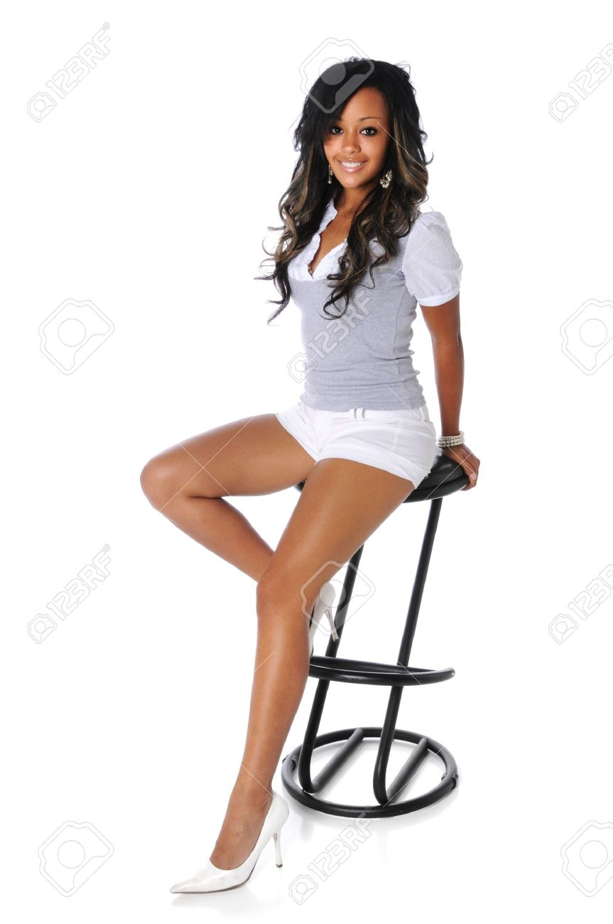 Beautiful African American woman sitting on a stool Stock Photo - 7803743