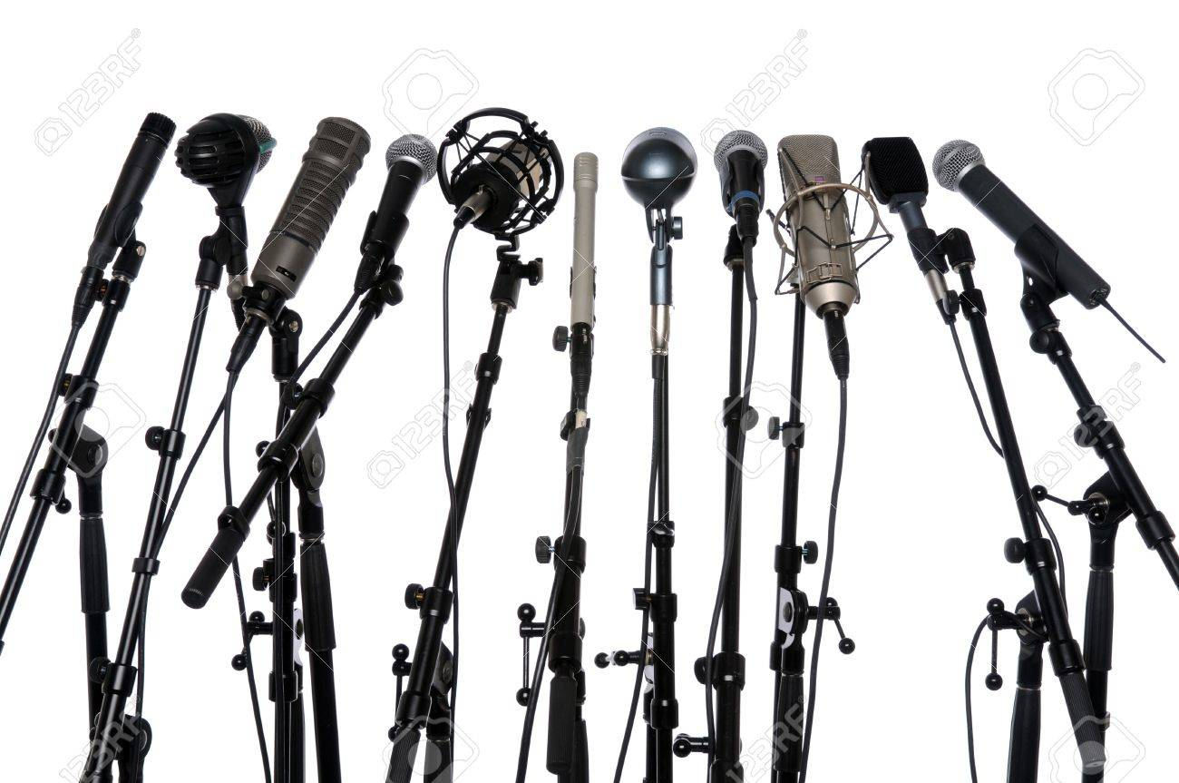 Microphones aligned together isolated over a white background Stock Photo - 7804263