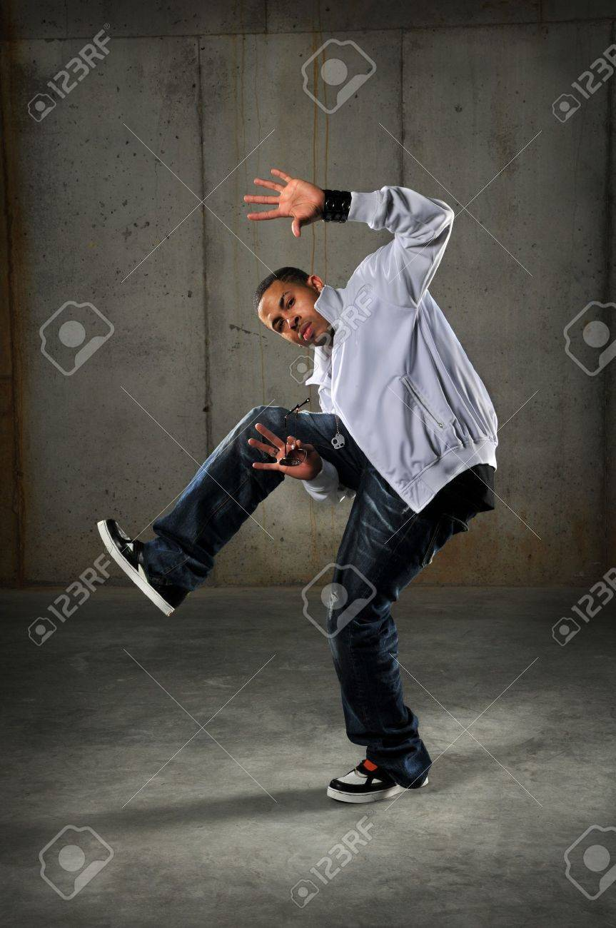 African American hip hop dancer performing over grunge background Stock Photo - 7888599
