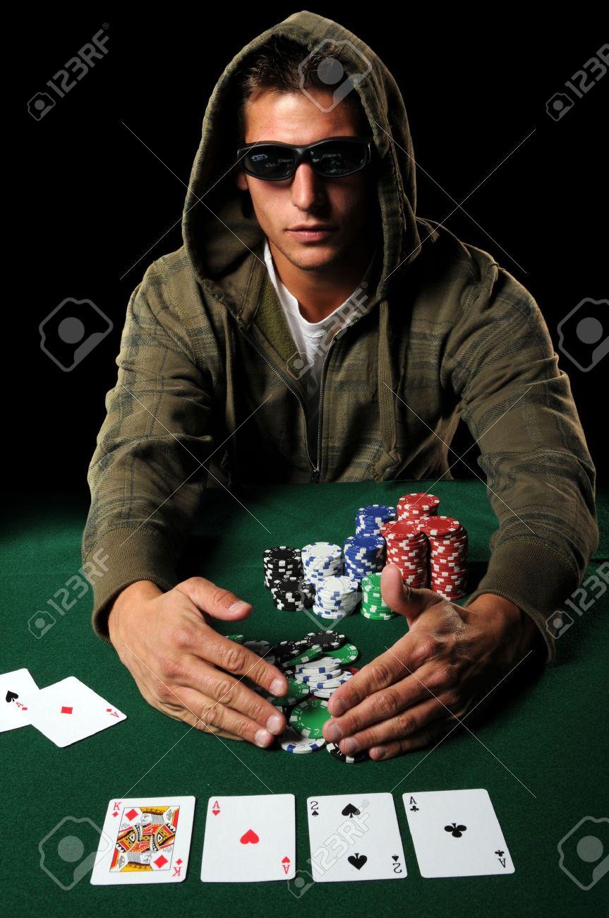 Poker player with sunglasses gathering winning chips Stock Photo - 7956286