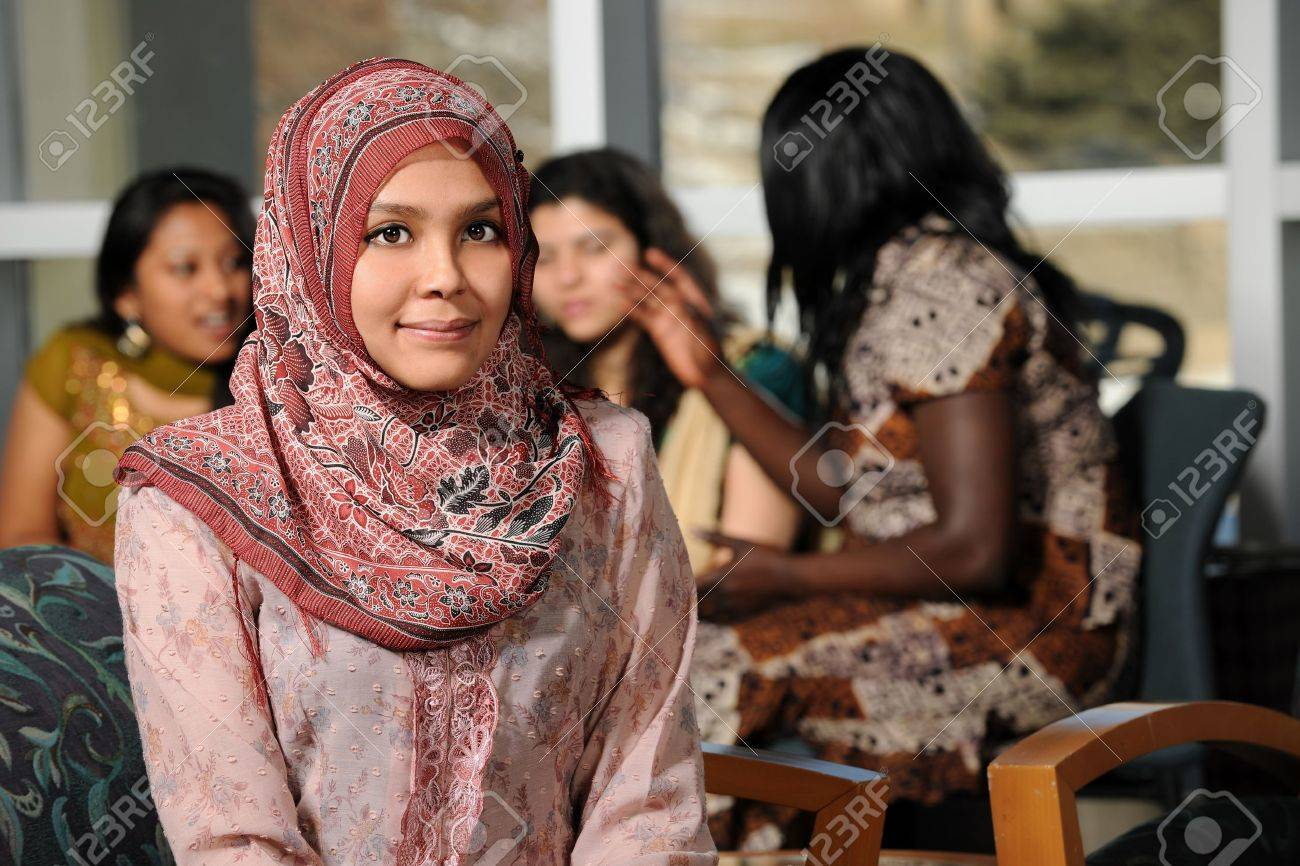 Islamic Young woman with diverse group of female students dressed in traditional clothing inside school setting Stock Photo - 15122557
