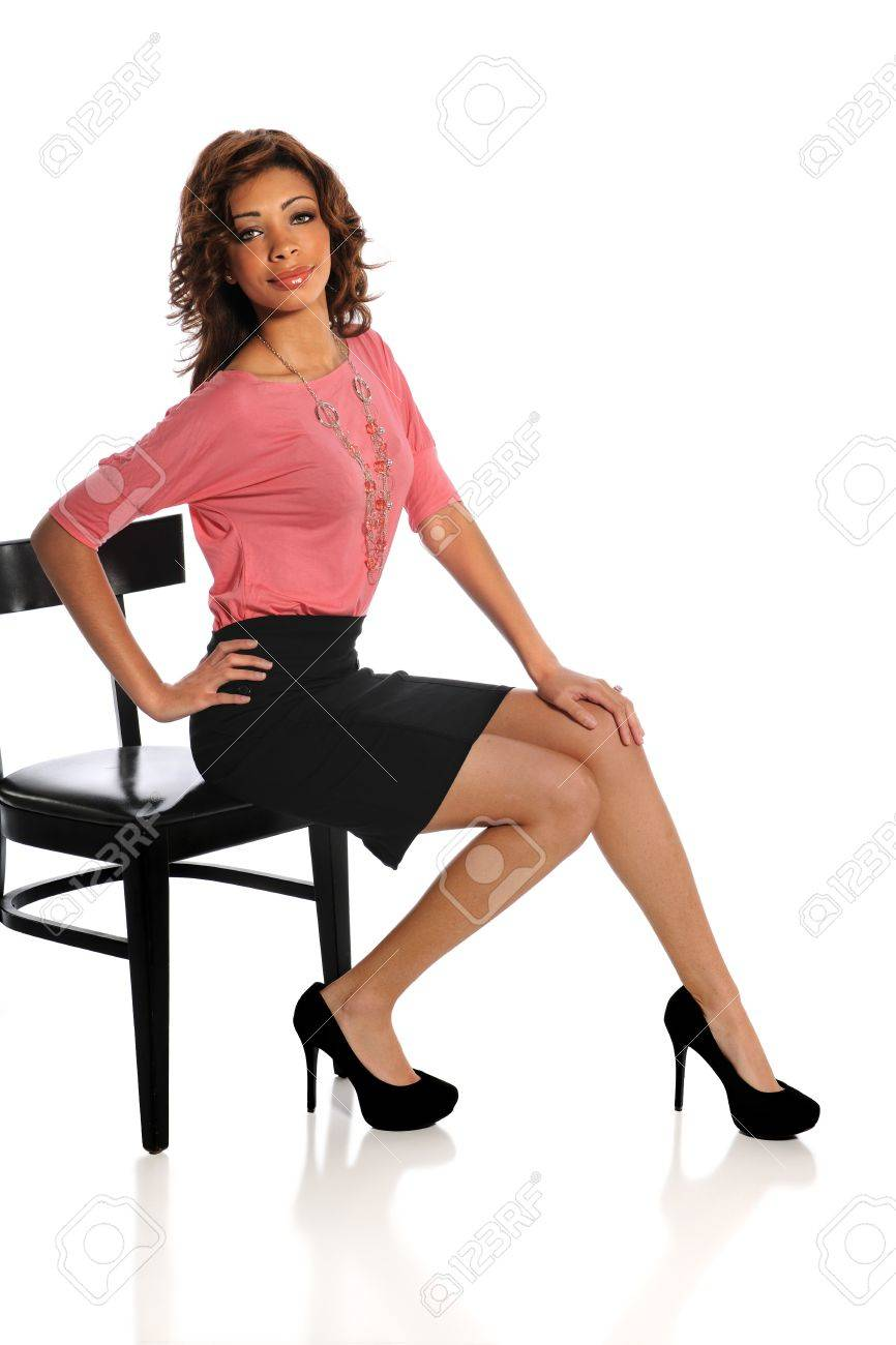 Beautiful African American woman sitting on black chair isolated over white background Stock Photo - 15513829