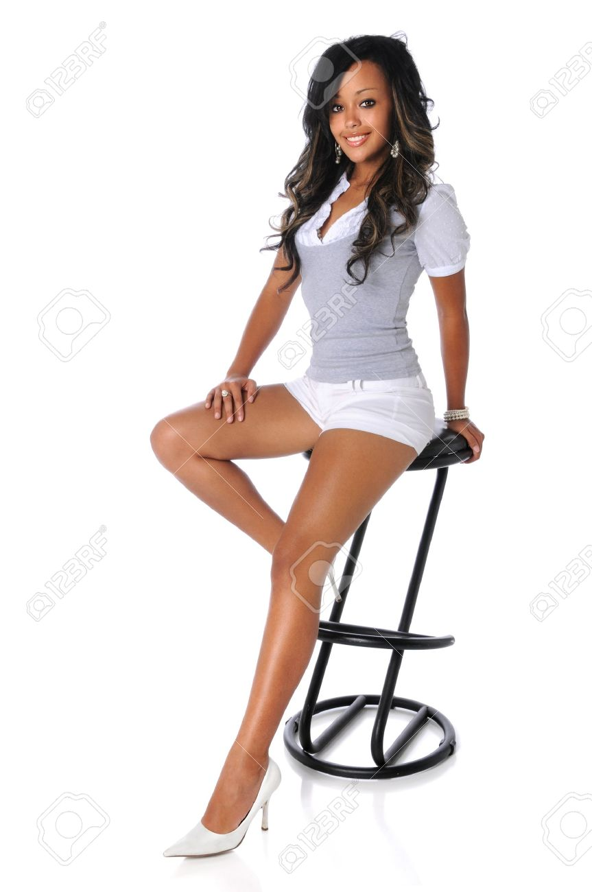 Young African American woman sitting on stool isolated over white background Stock Photo - 15673346