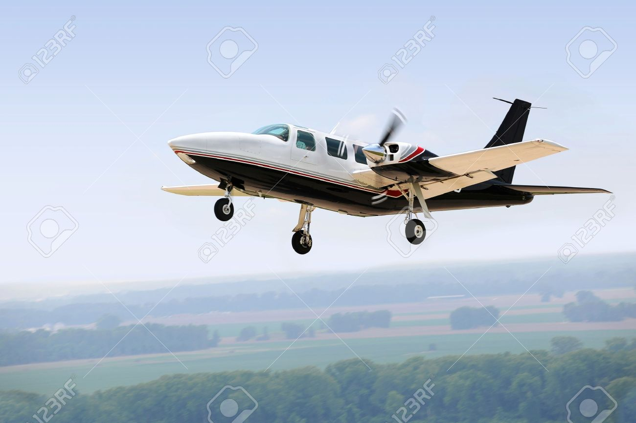 airplane landing or taking off with gear down stock photo picture airplane landing or taking off with gear down stock photo 15673652