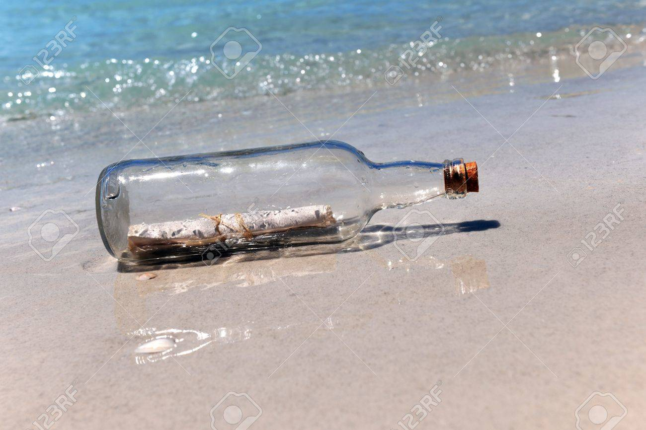 Message in a bottle on sandy shore Stock Photo - 15705893
