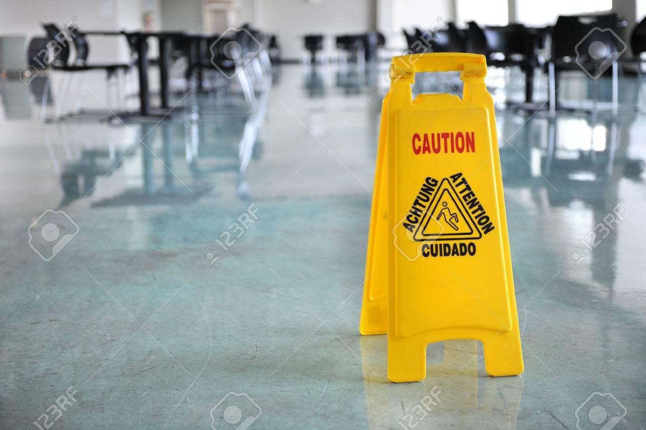 Caution yellow sign inside building hallway - 30357120