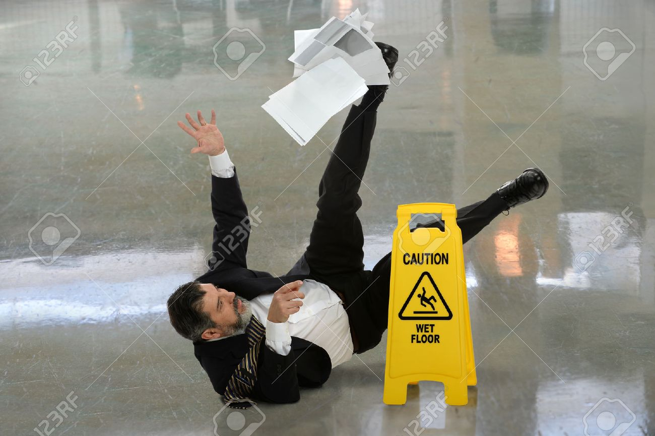Senior businessman falling on wet floor in front of caution sign - 31137423