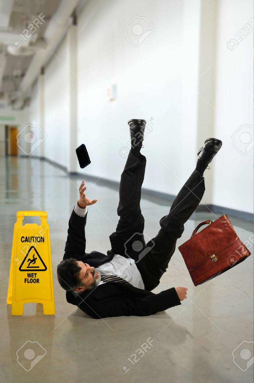 Mature businessman falling on wet floor inside building hallway - 31850669