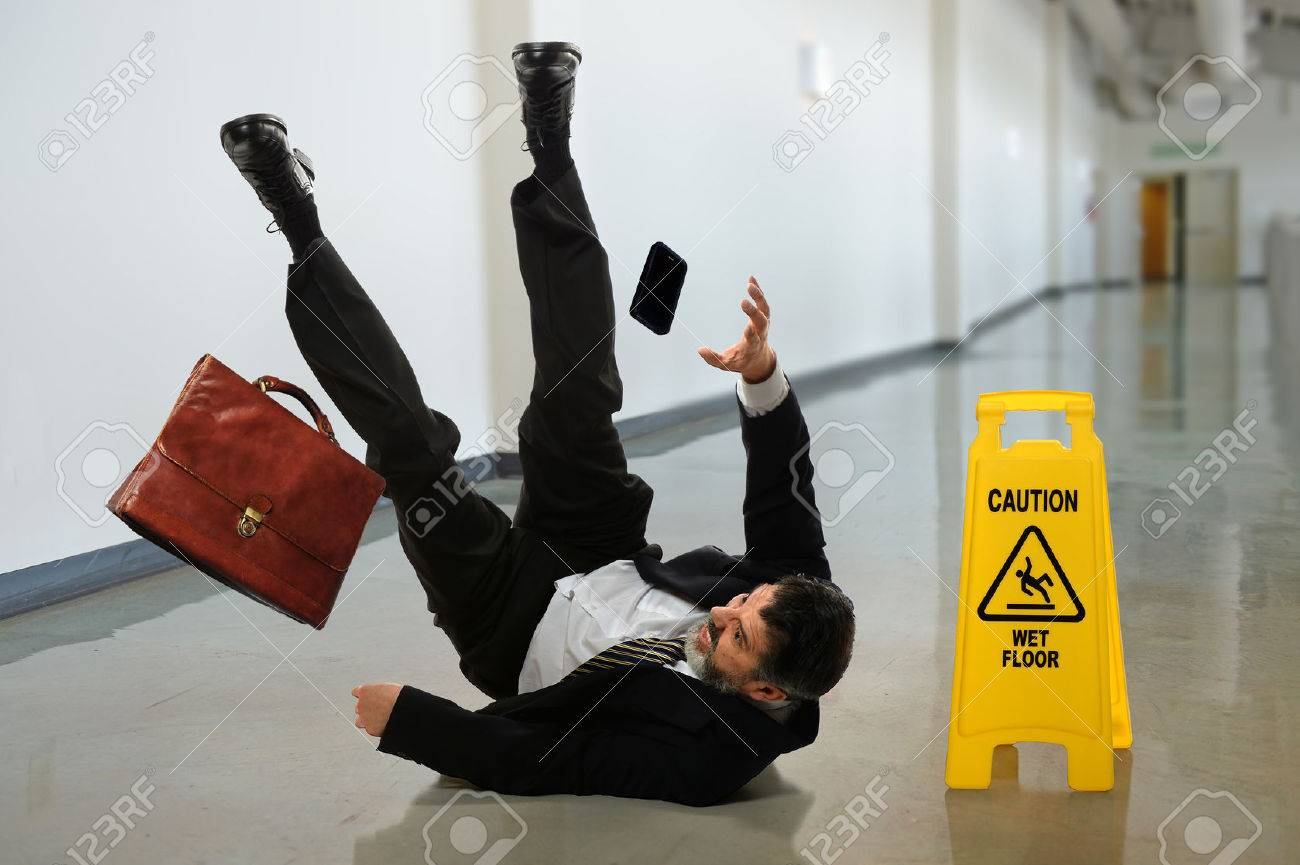 Senior businessman falling near caution sign in hallway - 31850692