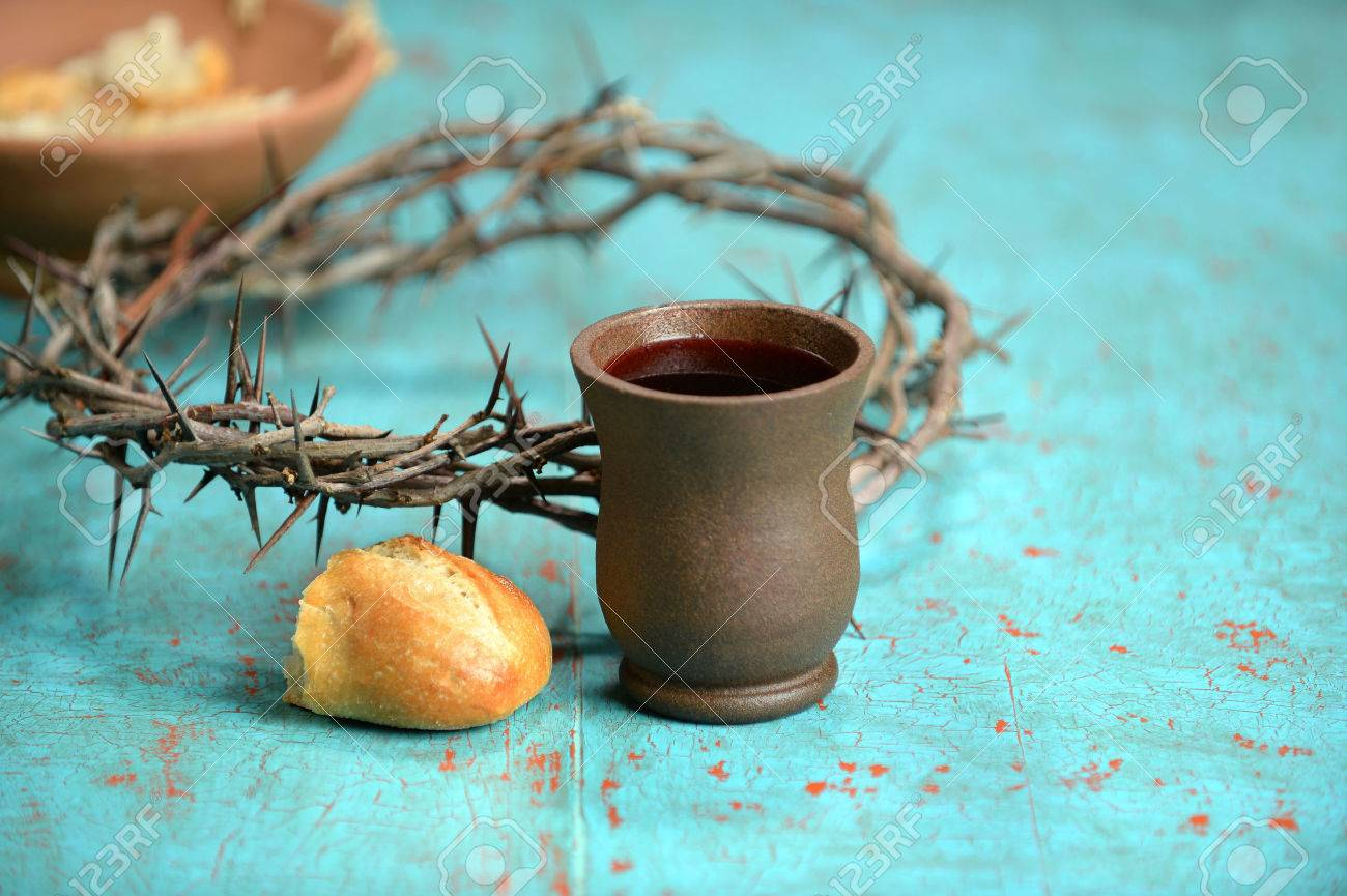 Bread, wine and crown of thorns on vintage table - 35010016