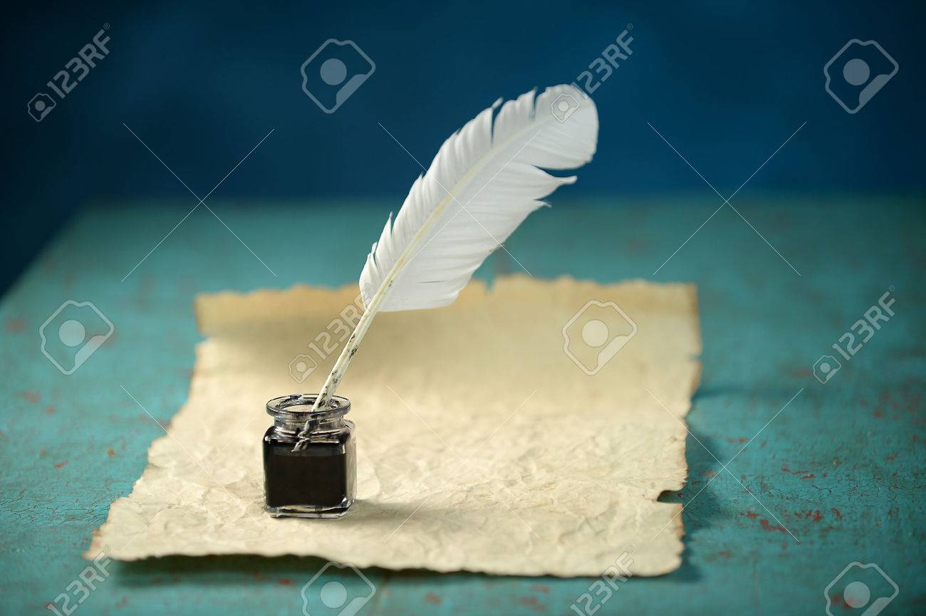 Writing Inkwell with feather and vintage paper on table - 35010018