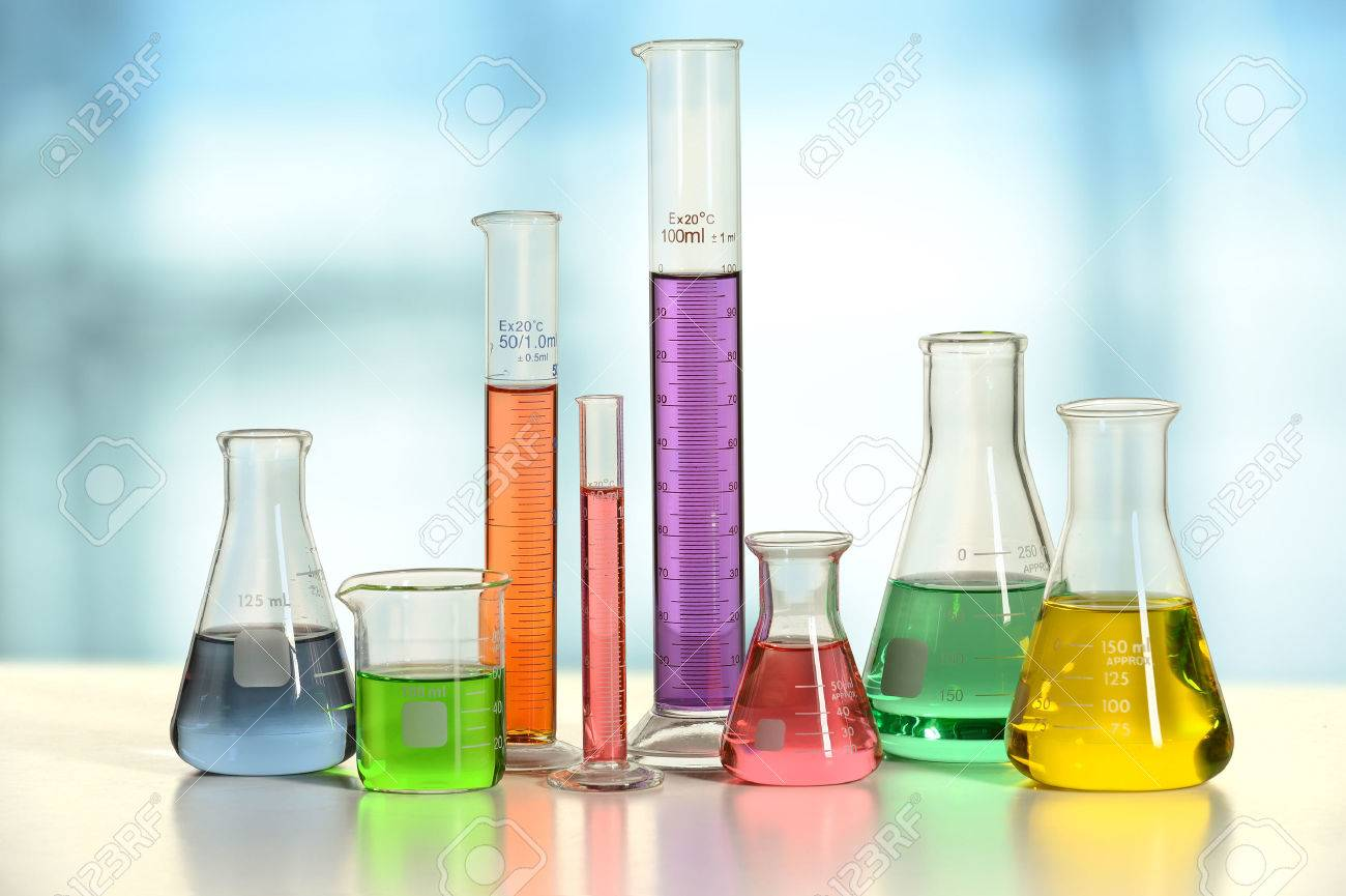 Laboratory glassware with liquids of different colors on white table - With clipping path on glass - 47647302