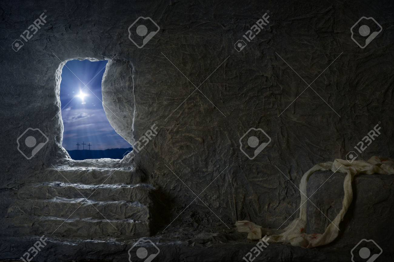 Empty tomb of Jesus at night with crosses in background - 53156026