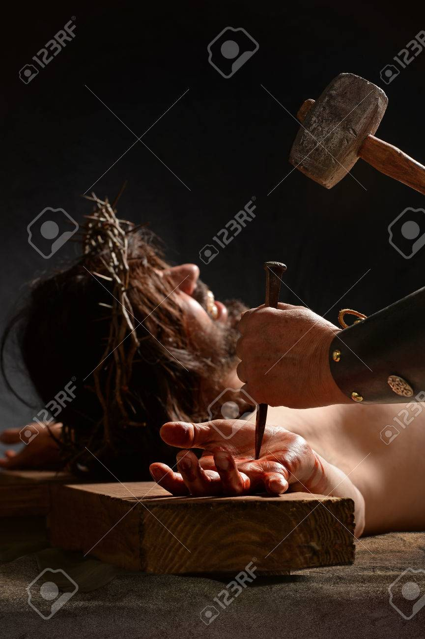 Jesus Hand Being Nailed To The Cross By Roman Soldier Stock Photo ...
