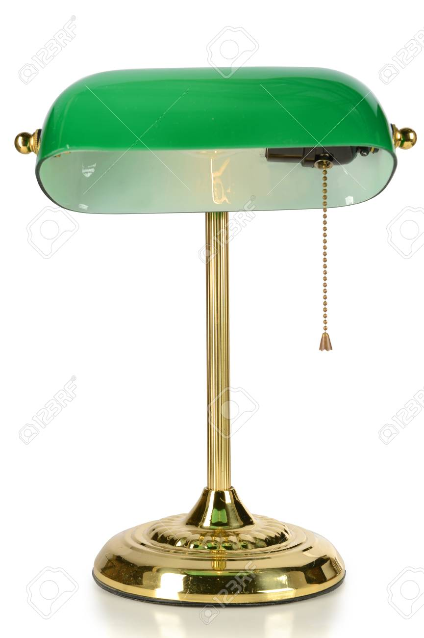 Vintage desk lamp with green glass shade isolated over white..