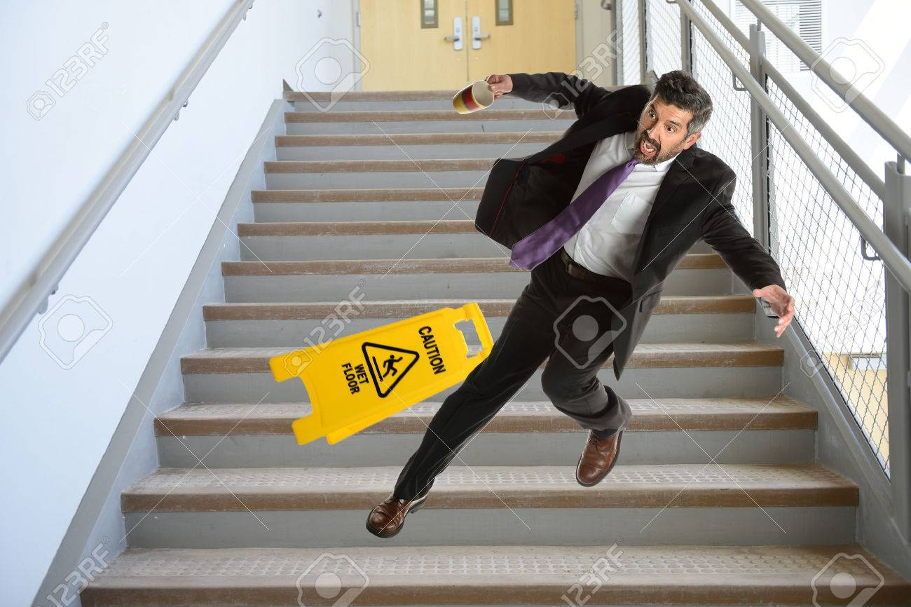 Mature Hispanic Businessman Falling Down The Stairs Stock Photo
