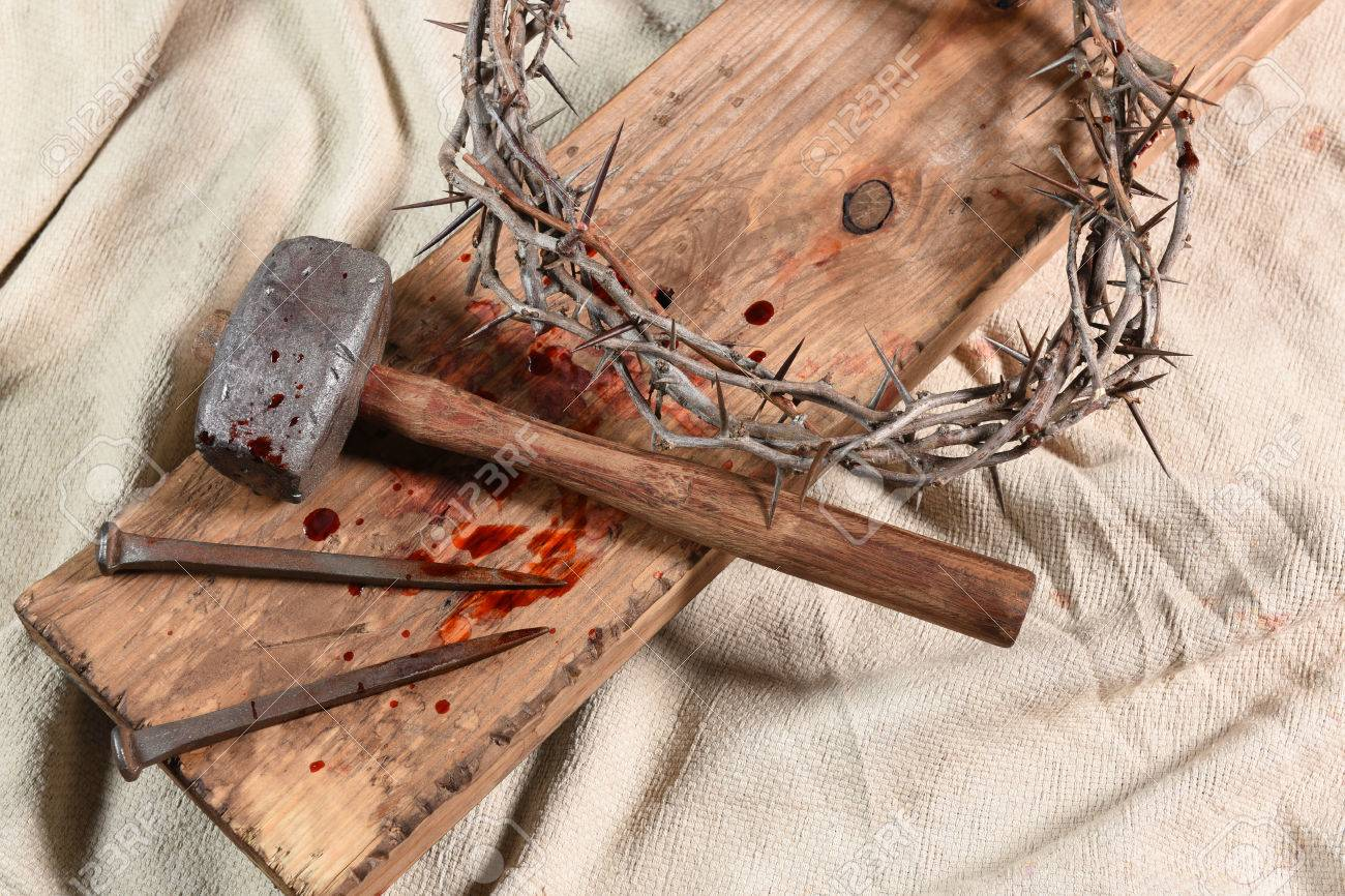 Crown of thorns, nails, and mallet over vintage cloth - 63738418