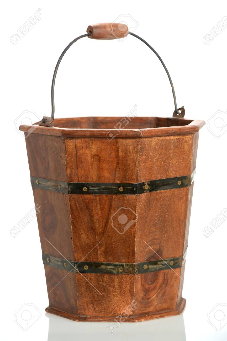 Vintage wooden bucket isolated over white background - 63739647
