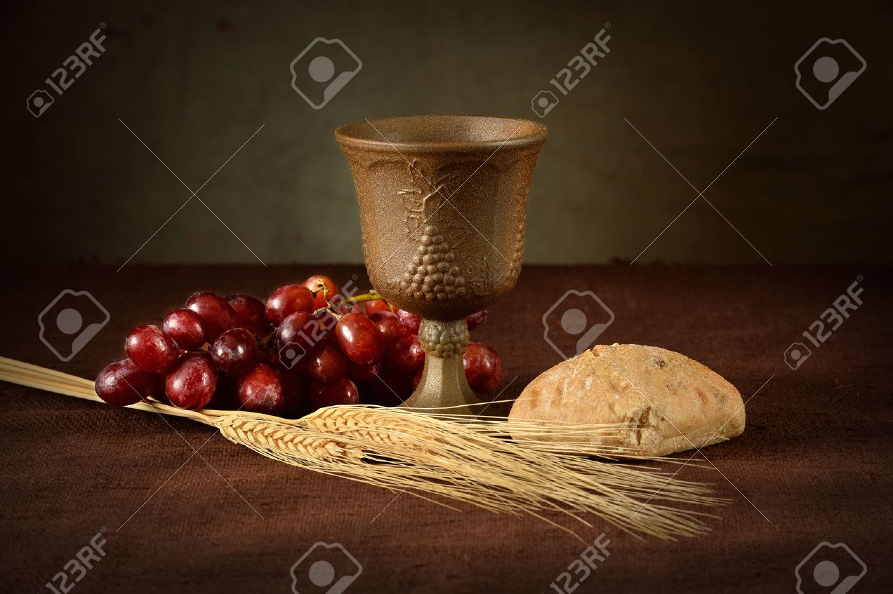 Cup Of Wine Red Grapes Bread And Wheat As Symbols Of Communion