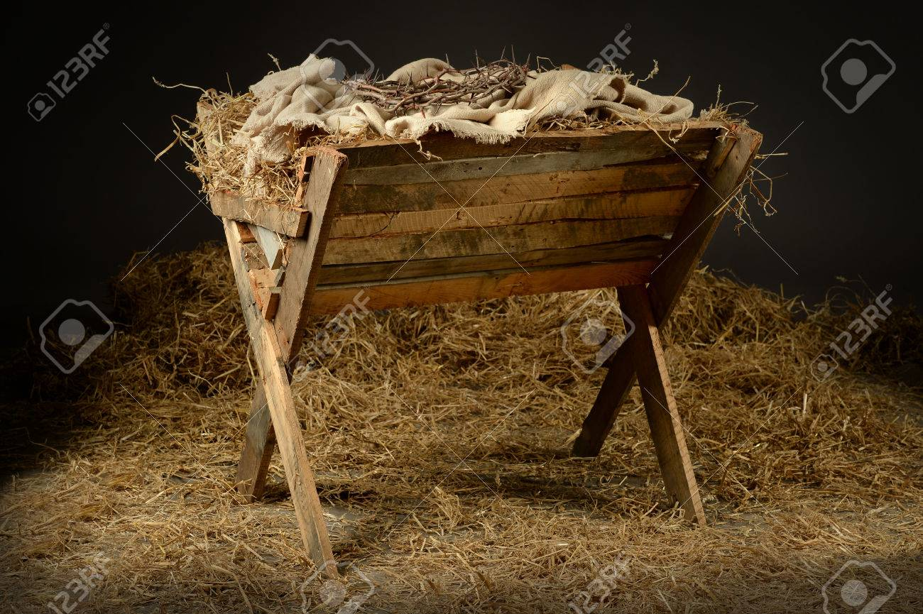 Manger with crown of thorns in barn. Concept based on the birth and death of Jesus. - 63774097