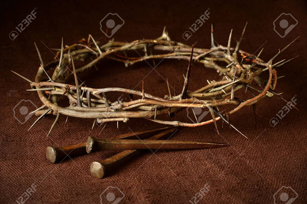 Crown of thorns and nails over vintage cloth - 63774225
