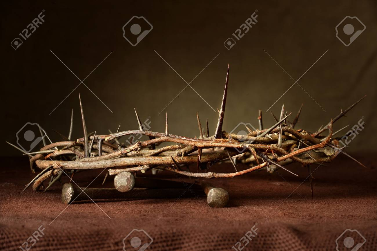 Nails and crown of thorns on cloth - 63778047