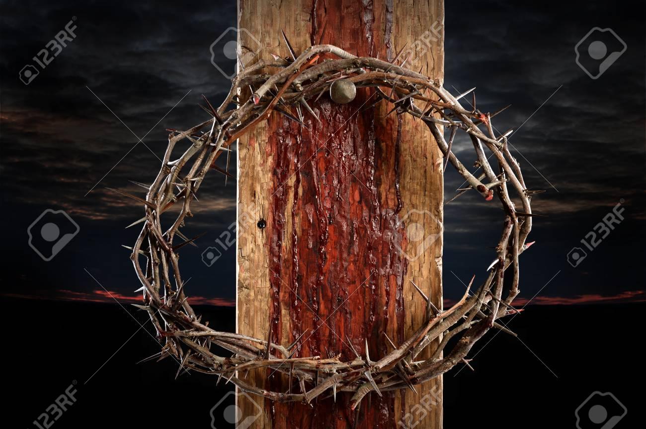 Crown of thorns cross held by nail - 67548840