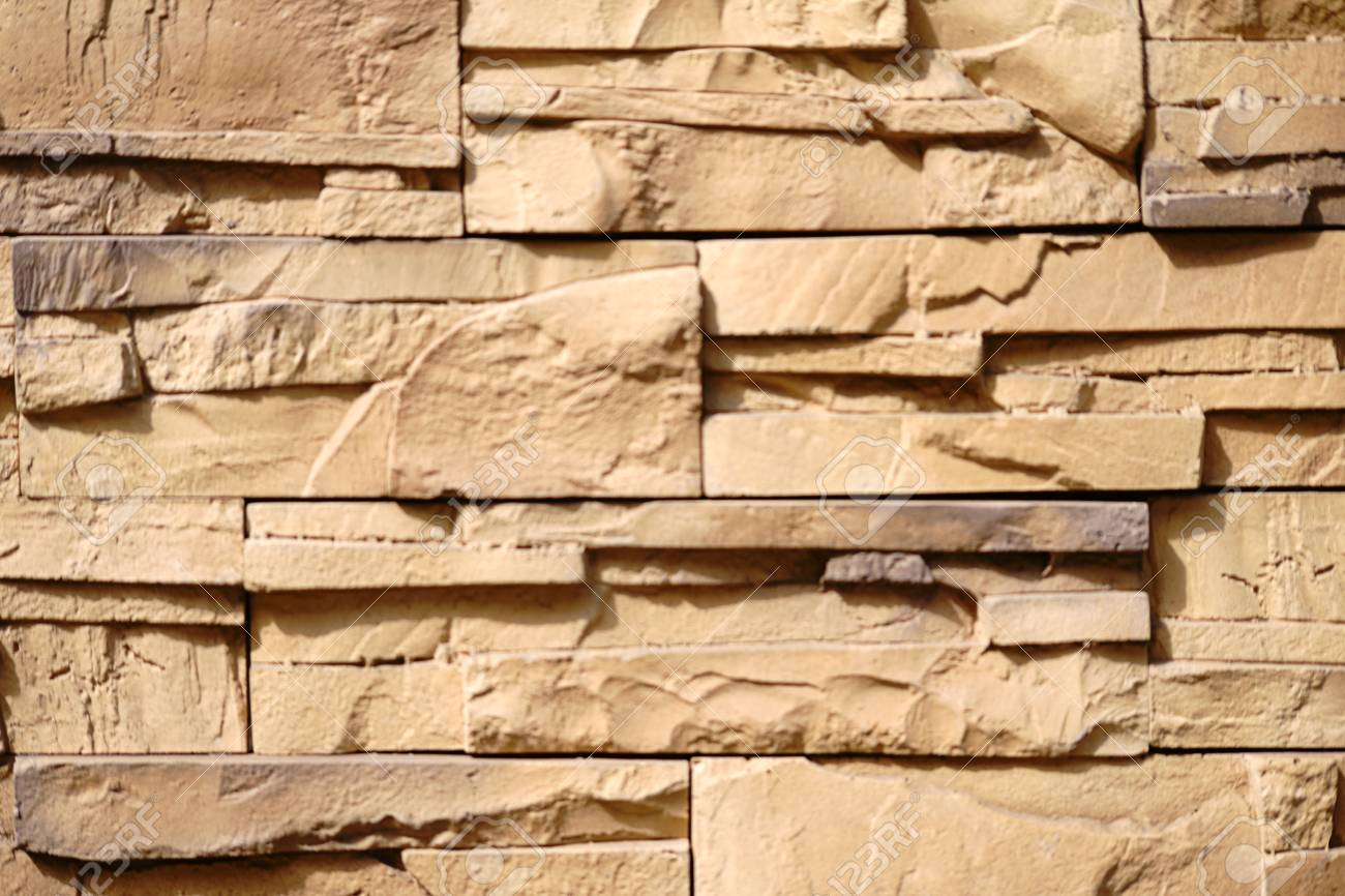 A Wall Decoration Made Of Staggered And Broken Clinker Bricks