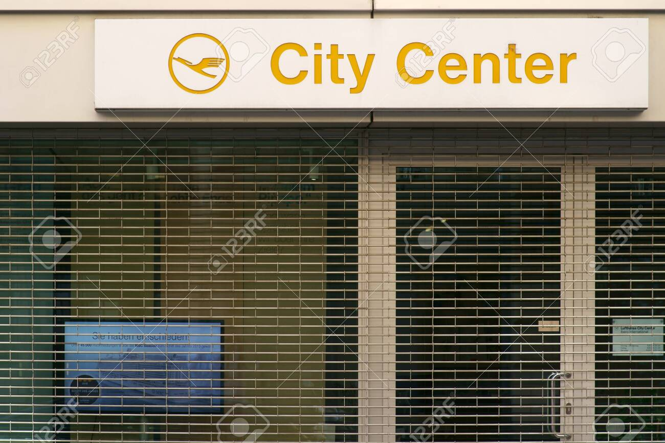 Frankfurt, Germany - July 06, 2019: The logo of the travel agency Lufthansa City Center over the barred shop window of a closed shop on 06 July 2019 in Frankfurt. - 128405407