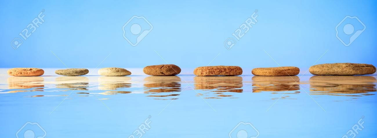Zen stepping stones on blue background, reflections on the water - 85256623