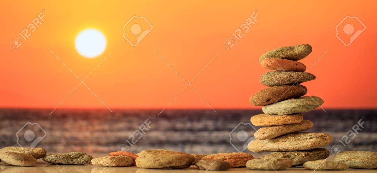 Zen stones stacked on sea background at sunset - 85256633