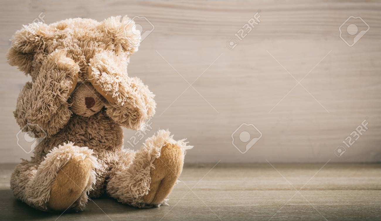 Child abuse concept. Teddy bear covering eyes in an empty room - 85562135