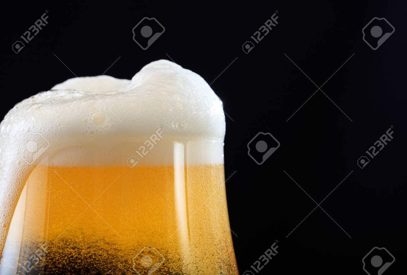 A glass of beer closeup on black background, copy space - 88626863