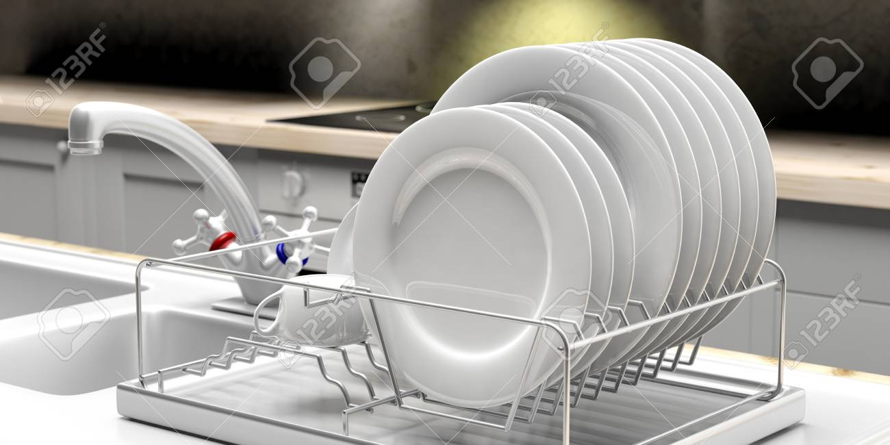 Dish Drying Rack With White Clean Plates On A White Kitchen Sink ...