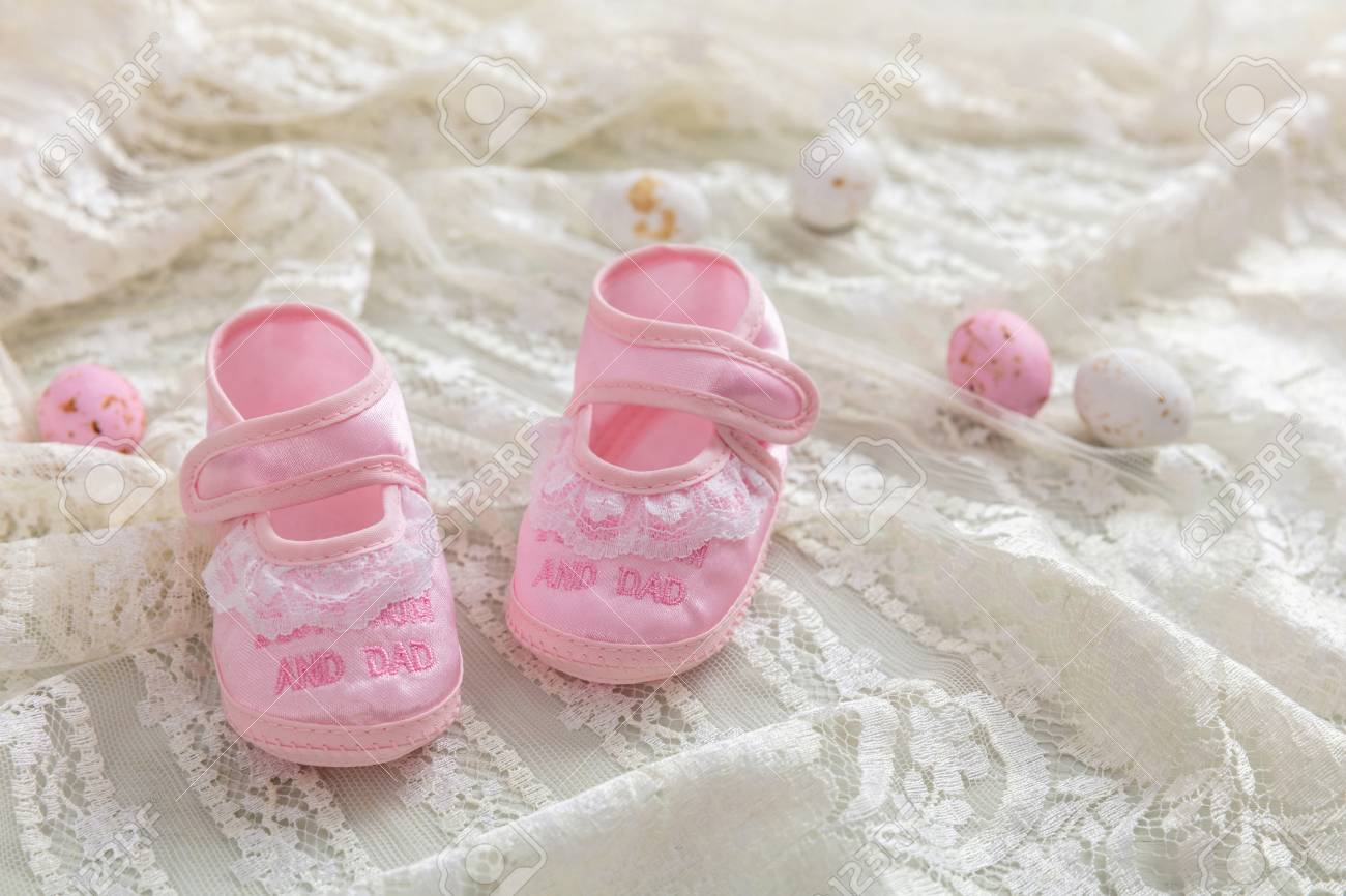 fe5cd7dca343b Baby girl shoes, shower invitation concept on white lace, blur..