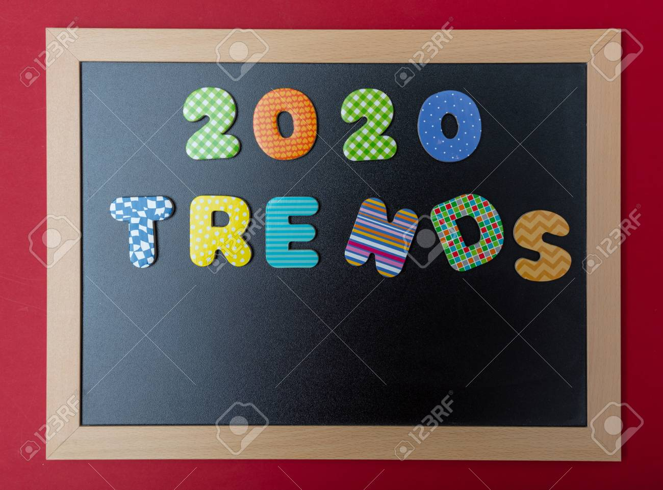 2020 New year trends  Black chalkboard with wooden frame, text
