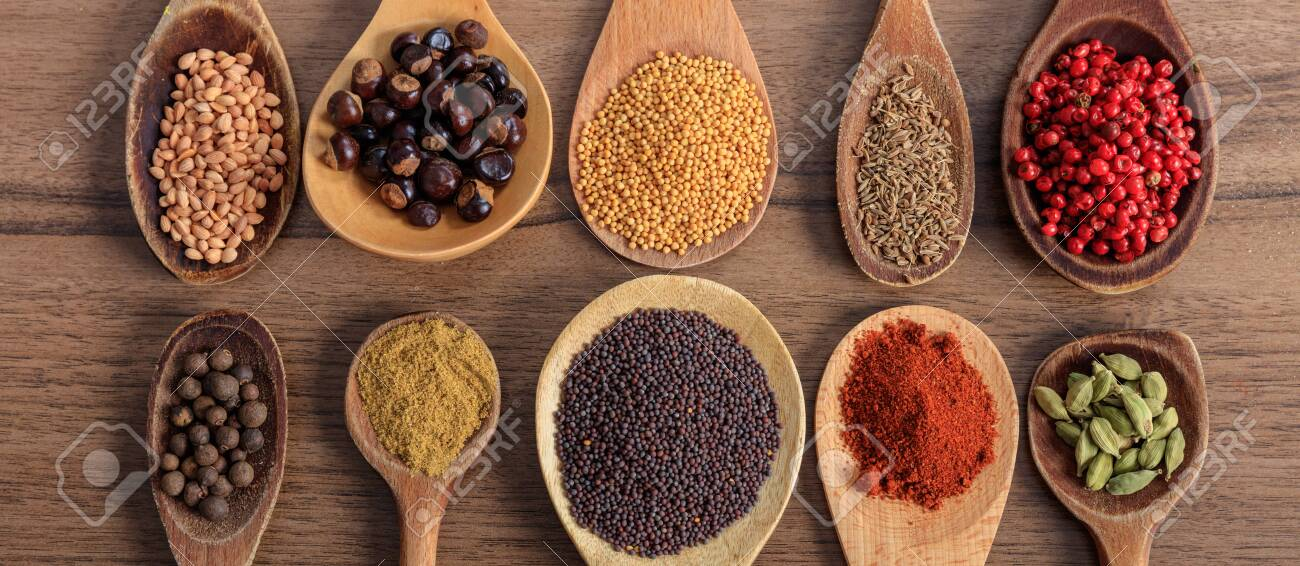 Spices and herbs. Colorful spices on wooden table, banner, top view - 120186247