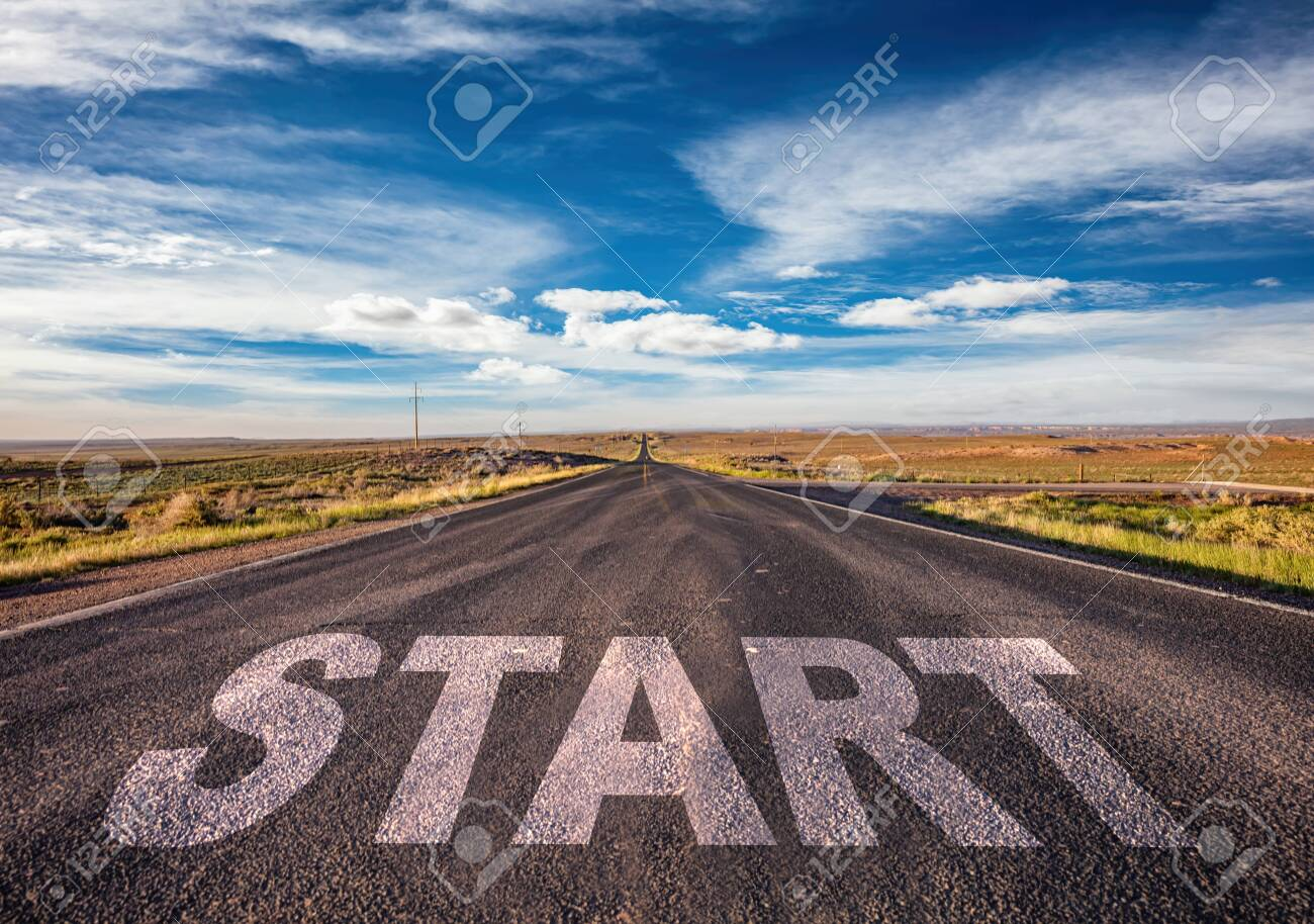 Start, new beginning concept. Text sign on a long straight highway in the american desert, blue cloudy sky background - 130112267