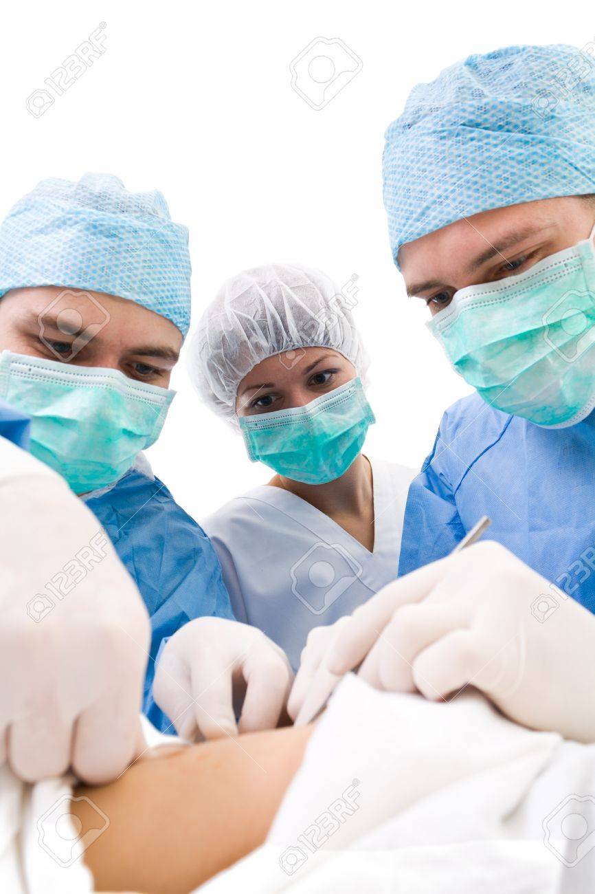 surgeons with patient on operation table during their work Stock Photo - 9524685