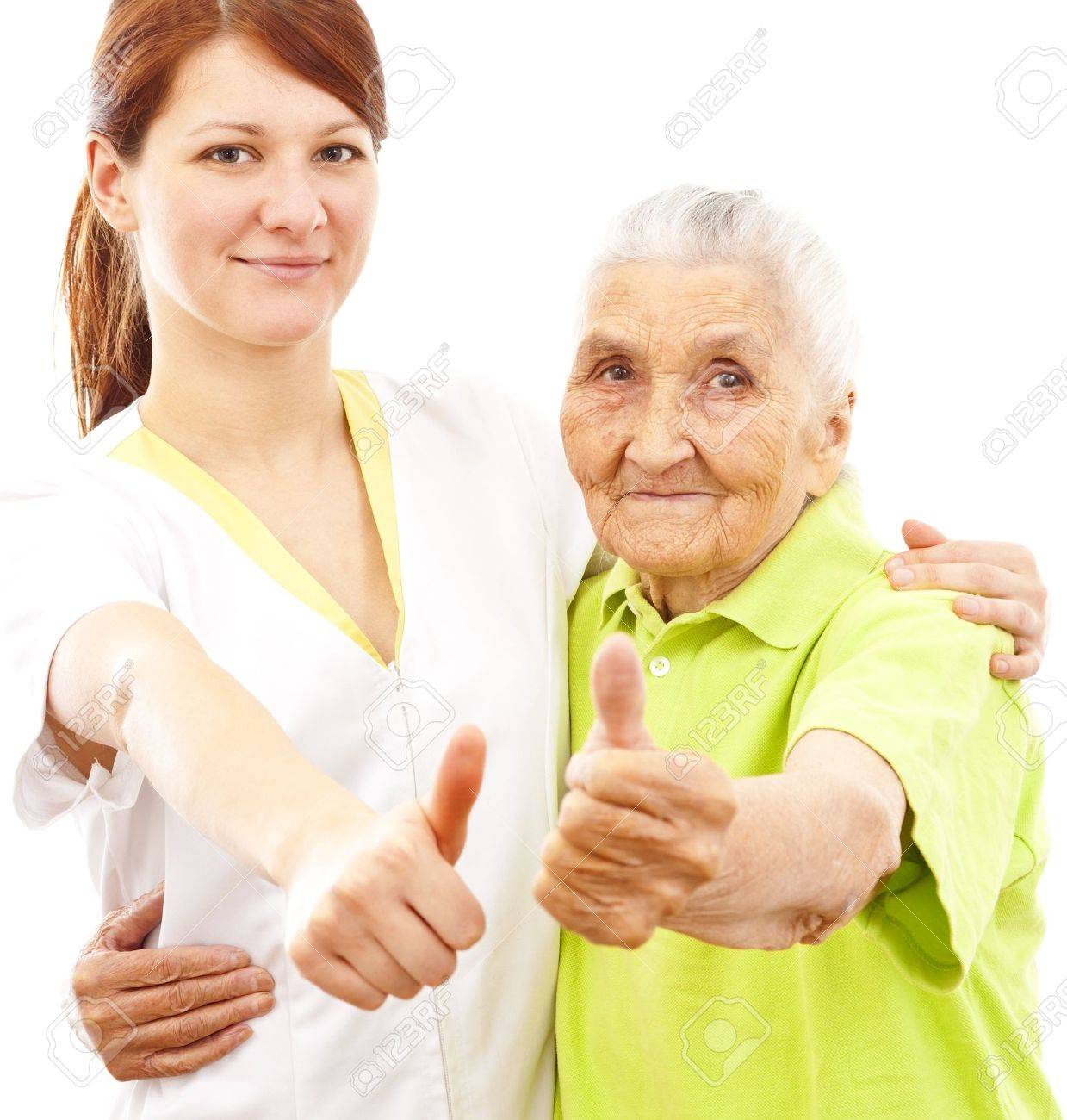 a young female doctor and a very old woman showing thumbs up Stock Photo - 11913884