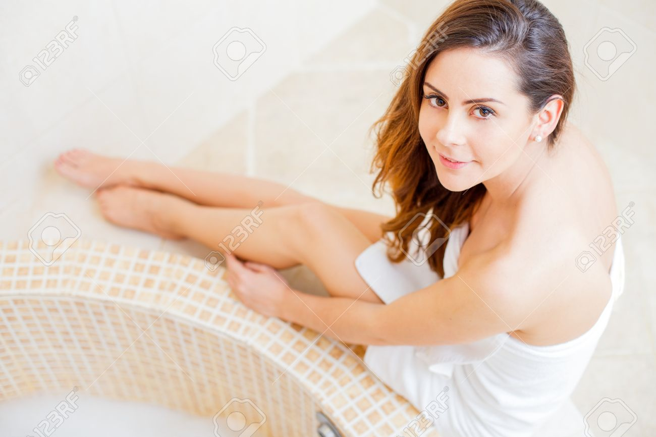 Hot bathroom pictures - Pretty Lady In The Bathroom In White Towel Preparing For A Hot Bath Stock Photo