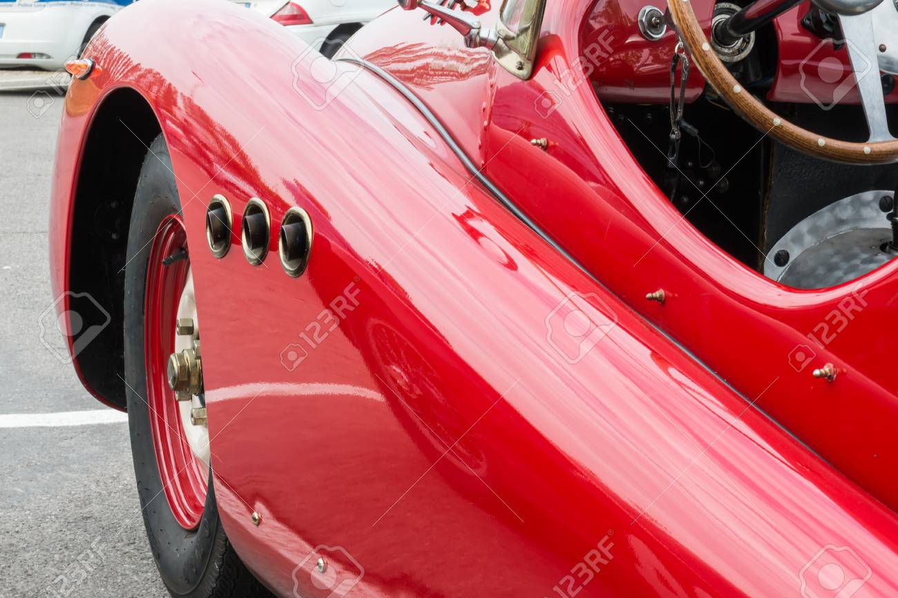 Side Exhaust Pipe Coming Out From Red Vintage Car Stock Photo