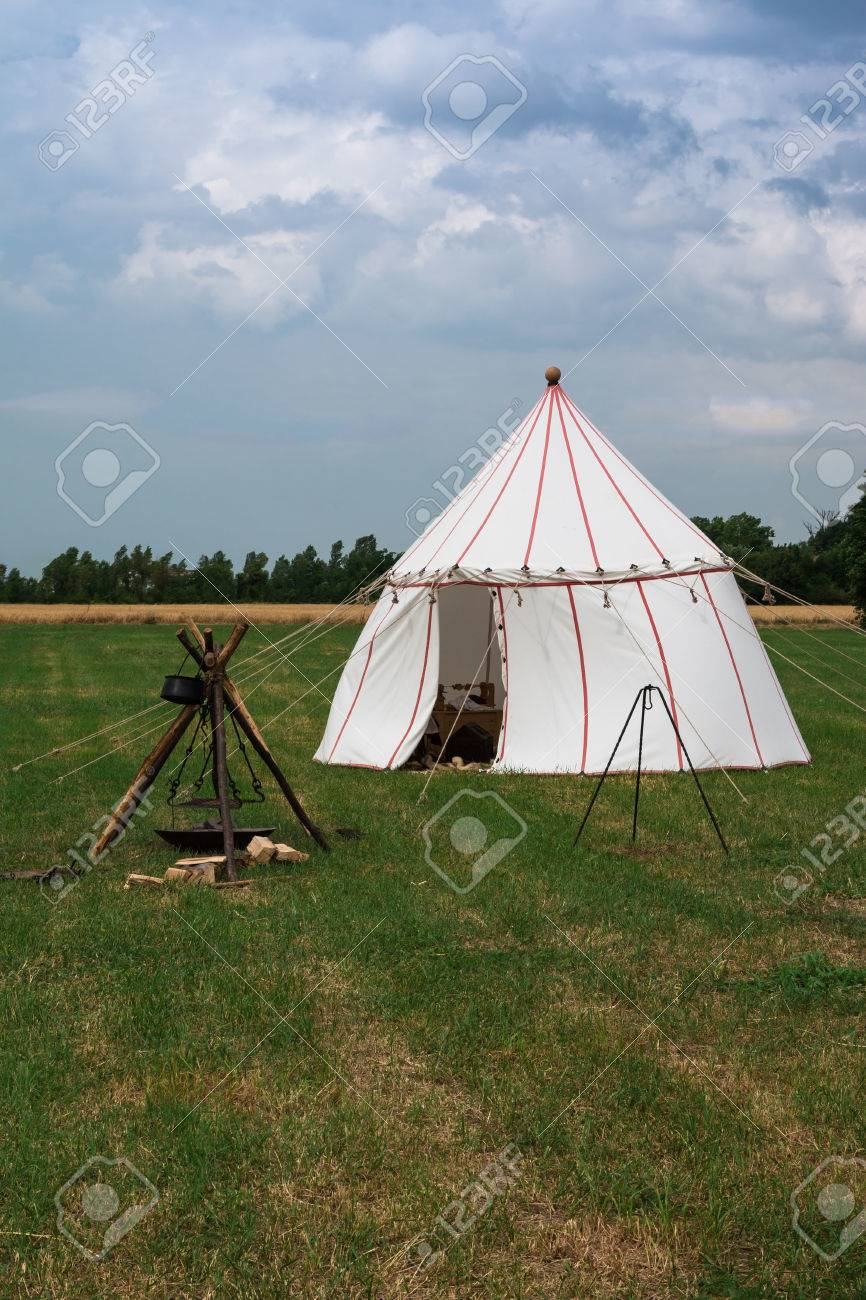White Tent and Wooden Tripod for Bonfire on Meadow Stock Photo - 78545084 & White Tent And Wooden Tripod For Bonfire On Meadow Stock Photo ...