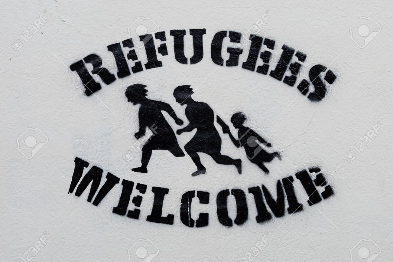 Welcome refugees text and sign stencil print on white wall stock welcome refugees text and sign stencil print on white wall symbol stock photo buycottarizona Gallery