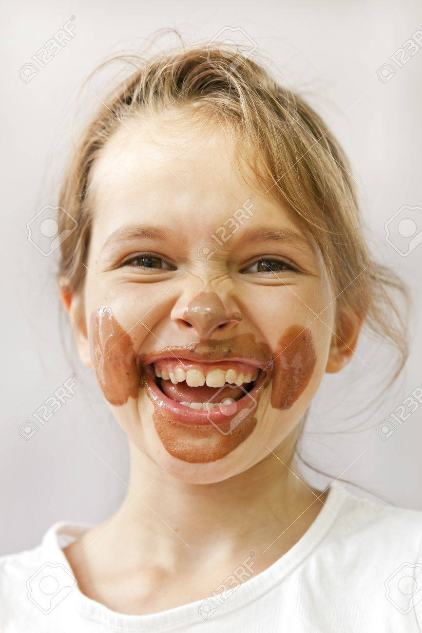 A Seven-year-old With Chocolate Ice Cream In The Face That Looks ...